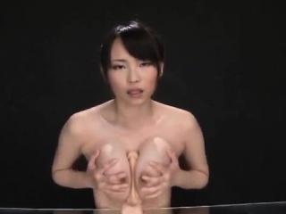 Akane Yoshinaga plays with dildo on cans