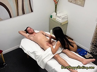 Naughty Masseuse Ember Snow Straddles Her Client