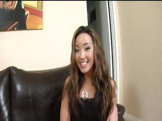 Big black cock fucks an asian girl on couch